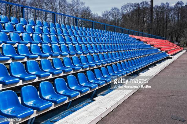 empty seats in row - heinovirta stock photos and pictures