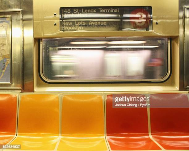 empty seats in subway train - subway train stock pictures, royalty-free photos & images