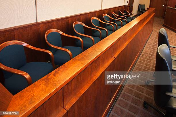 empty seats in the jurors row in the court room - juror law stock pictures, royalty-free photos & images