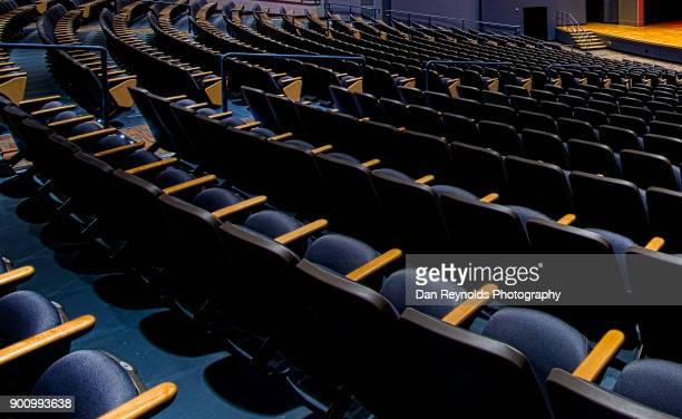 empty seats in theatre auditorium - concert hall stock pictures, royalty-free photos & images