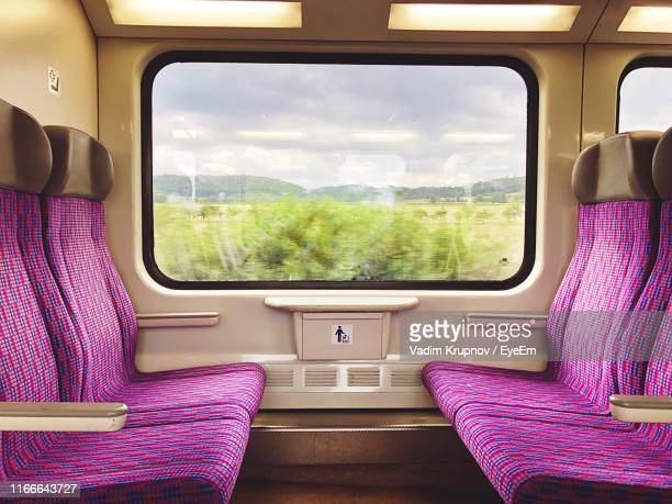 empty seats in train - vehicle interior stock pictures, royalty-free photos & images