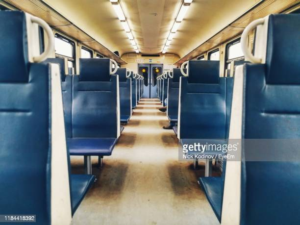 empty seats in train - train interior stock pictures, royalty-free photos & images