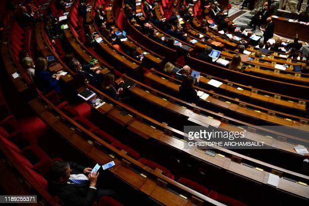 Empty seats of MPs are seen during a session of questions to the government at the National Assembly in Paris on December 17 2019