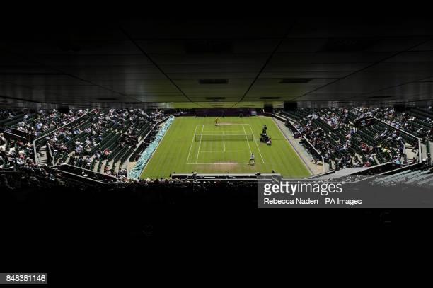 Empty seats on Centre Court during the First Round match in the Women's Singles between Belarus's Victoria Azarenka and Romania's IrinaCamelia Begu...