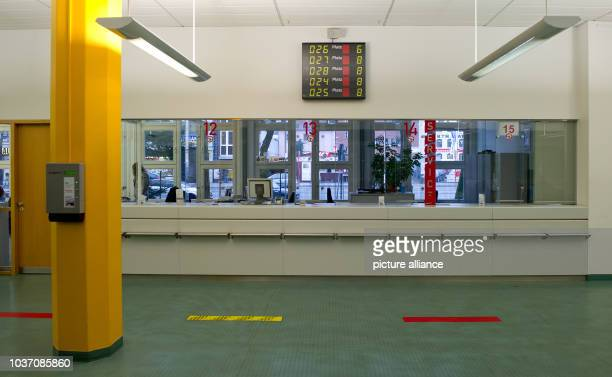 Empty service desks are pictured in a vehicle registration office in Hamburg Germany 26 February 2013 The trade unions Verdi GEW and GdP called for a...