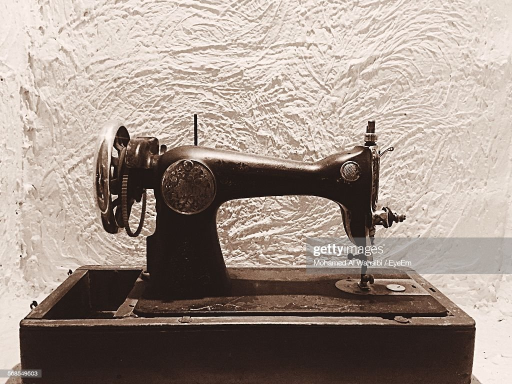 Empty Sewing Machine Against White Wall : Stock Photo