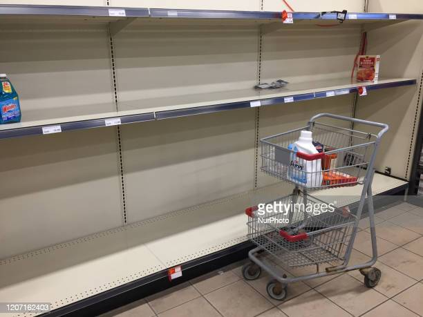 Empty shelf that contained soap and cleaning products as grocery stores were packed with big crowds and long lines as latest spike of COVID19 cases...