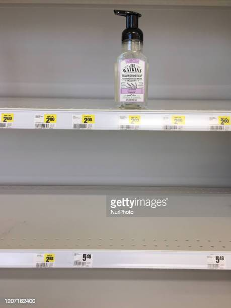 Empty shelf that contained soap as grocery stores were packed with big crowds and long lines as latest spike of COVID19 cases prompted panic buying...