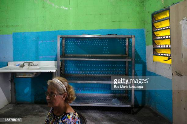 Empty shelves after lunch in a community kitchen of Petare on April 16 2019 in Caracas Venezuela Local NGOs offer food to those in need especially...