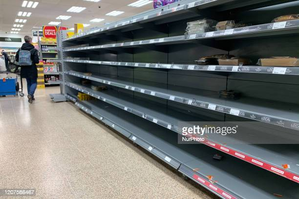 Empty Shelves and panic buying at a London COOP due to Coronavirus COVID19 in London United Kingdom on March 18 2020