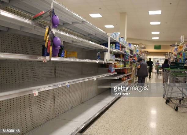 Empty shelves are seen after the water supply was emptied out of a grocery store by people in preparation for Hurricane Irma on September 5 2017 in...
