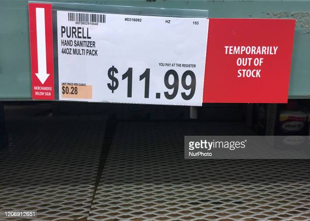 Empty shelves are seen at a BJ's Wholesale Club store on March 12 2020 in Orlando Florida as people stock up on hand sanitizer and other personal...