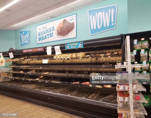 Empty shelves are visible in the meat section, with a sign reading Kosher Meat, at the Best Market supermarket on Long Island, Great Neck, New York...