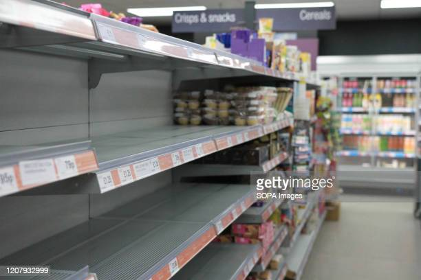 Empty Shelves at a cooperative store amid Coronavirus fears in Derby British Health Ministry recorded a total of 3983 infections 177 death and 65...