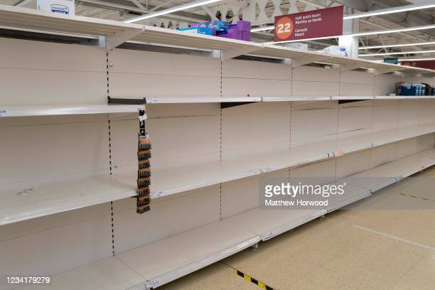 Empty shelves at a Sainsbury's store on July 25, 2021 in Cardiff, United Kingdom. Supermarkets across the UK are emptying of fresh produce and...