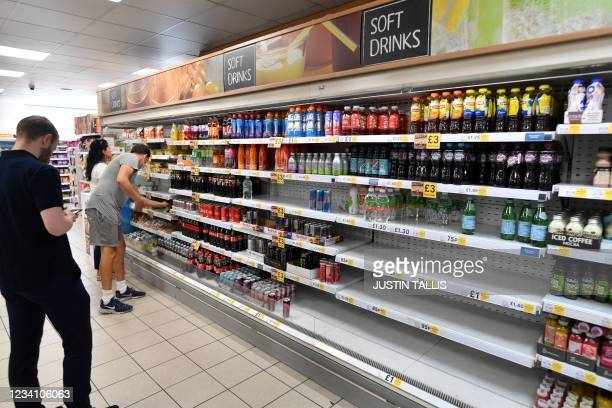 Empty shelves at a Tesco supermarket in central London on July 22, 2021. - British supermarkets and suppliers warned today of possible food shortages...