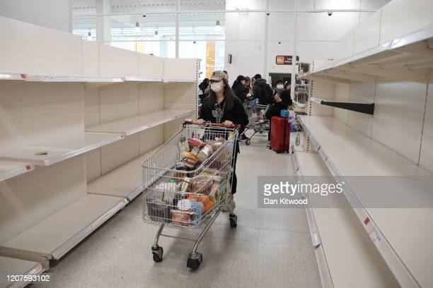 Empty shelves confront shoppers at the Nine Elms branch of Sainsburys supermarket on March 18 2020 in London United KingdomCoronavirus has spread to...