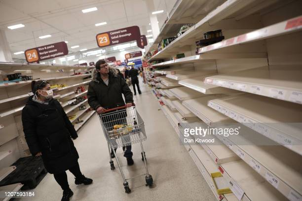 Empty shelves confront shoppers at the Nine Elms branch of Sainsburys supermarket on March 18 2020 in London United Kingdom Coronavirus has spread to...