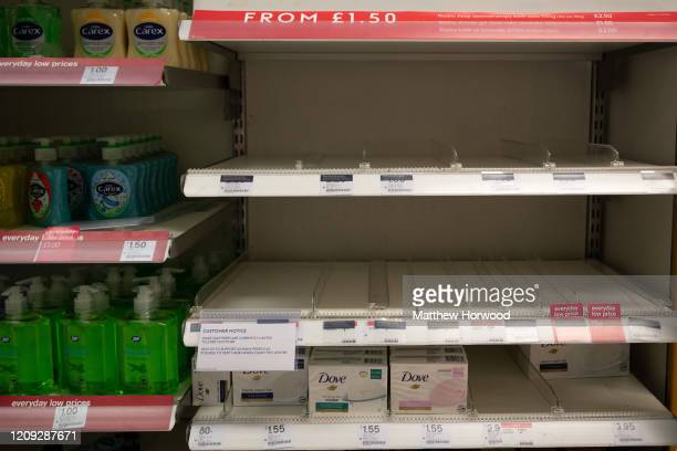 Empty shelves in a Boots chemist after the retailer ran out of hand sanitiser following a limiting sales to two per customer on February 28 in...