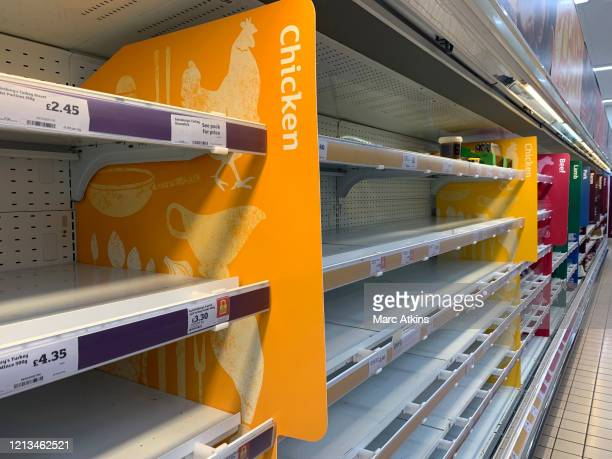 Empty shelves in a branch of Sainsbury' Supermarket after spates of panic buying cleared supermarket shelves of items like toilet paper and cleaning...