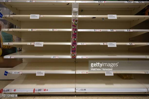 Empty shelves in a Cardiff Tesco store on March 9 2020 in Cardiff United Kingdom The retailer has put in place measures to limit the number of...