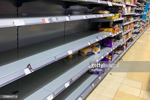 Empty shelves in a Tesco store in Kent as shoppers stockpile basic consumer goods for fears of a potential quarantine due to an outbreak of...