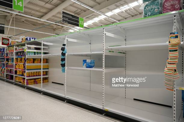 Empty shelves in an ASDA store in Cardiff Bay where toilet roll used to be on sale on September 26, 2020 in Cardiff, Wales. A local lockdown comes...