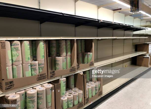 Empty shelves in Paper Products Aisle at Keyfoods store, Queens, New York.