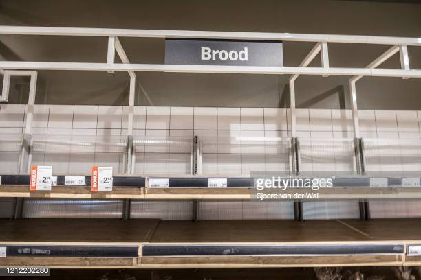 Empty shelves in the Dutch supermarkets in Kampen after the announcement by the government of new measures for prevention of the spread of the...