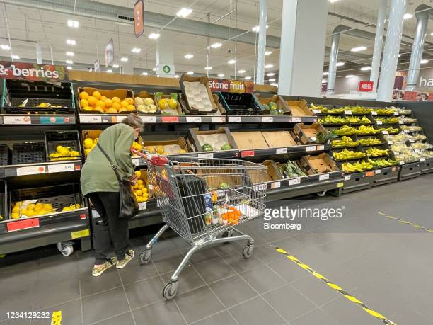 Empty shelves in the fresh fruit aisle at a J Sainsbury Plc in London, U.K., on Friday, July 23, 2021. The U.K. Government is rolling out daily Covid...