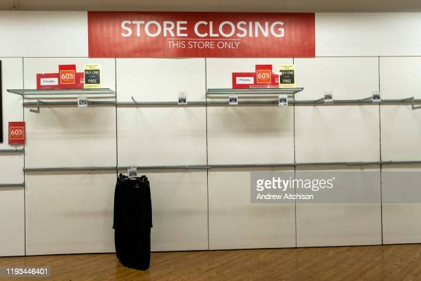 Empty shelves inside the Folkestone Debenhams store in the final few days of the Everything Must Go sale before closing down on 13th Jauary 2020 in...