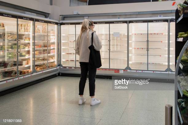 empty shelves - panic buying stock pictures, royalty-free photos & images
