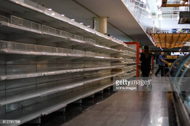 Empty shelves seen at a supermarket in Caracas As Many of the products have been regulated by the government of President Nicolas Maduro and the...
