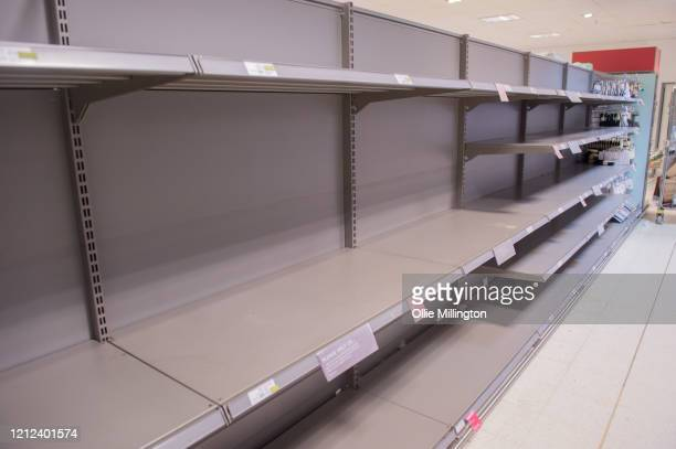 Empty shelves seen in the Canary Wharf Waitrose store on March 14 2020 in London England The British public have been given the news mass gatherings...