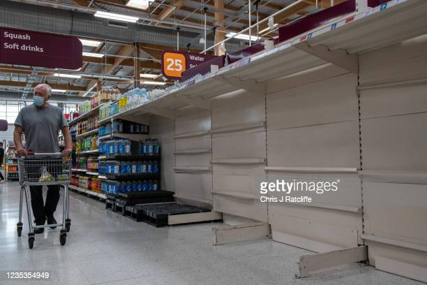 Empty shelves that usually stock bottled water at Sainsbury's supermarket, Greenwich Peninsular, on September 19, 2021 in London, England. Gaps in...