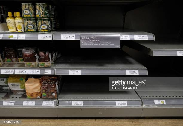 Empty shelves where packets of flour would normally be stocked are pictured below half-empty egg, and sugar stocks, inside a Waitrose supermarket...