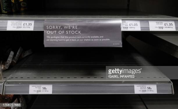 Empty shelves where packets of flour would normally be stocked are pictured below halfempty egg and sugar stocks inside a Waitrose supermarket store...
