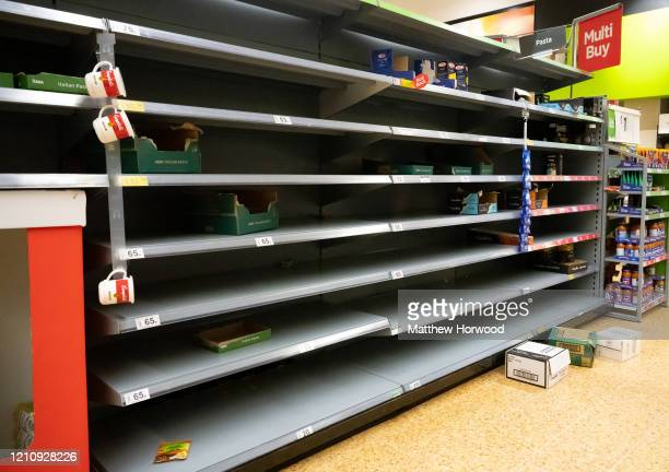 Empty shelves where pasta was on sale in an ASDA store on March 6, 2020 in Cardiff, United Kingdom. Coronavirus has spread to 88 countries in a...