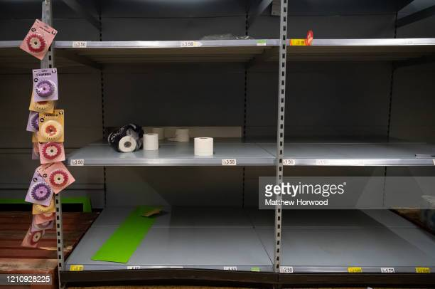 Empty shelves where toilet roll was on sale in an ASDA store on March 6, 2020 in Cardiff, United Kingdom. Coronavirus has spread to 88 countries in a...