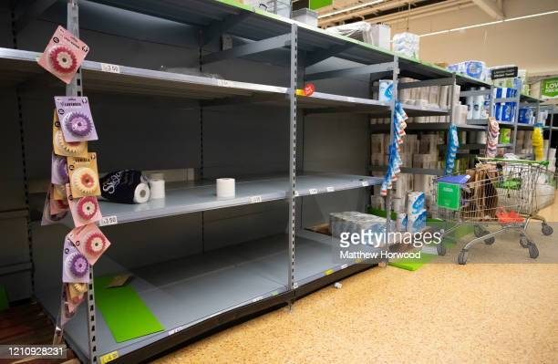 Empty shelves where toilet roll was on sale in an ASDA store on March 6 2020 in Cardiff United Kingdom Coronavirus has spread to 88 countries in a...