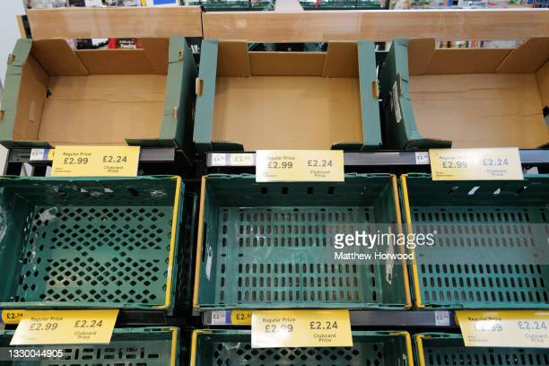 Empty shelves where watermelon was being sold at a Tesco store on July 21, 2021 in Cardiff, United Kingdom. Supermarkets across the UK are emptying...