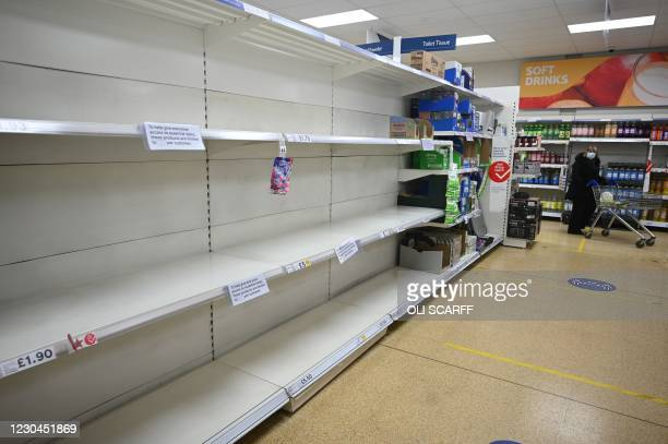 Empty shelves which previously held toilet paper are pictured at a supermarket in Cleckheaton, West Yorkshire, on January 6 on the second day of...