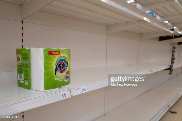 Empty shelves which would normally hold toilet roll at a Sainsbury's store on July 25, 2021 in Cardiff, United Kingdom. Supermarkets across the UK...