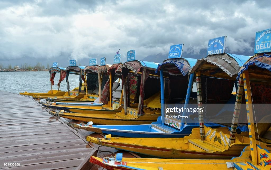 Empty Shikaras tied to a wooden pier at world famous Dal Lake in Srinagar, the summer capital of Indian controlled Kashmir.