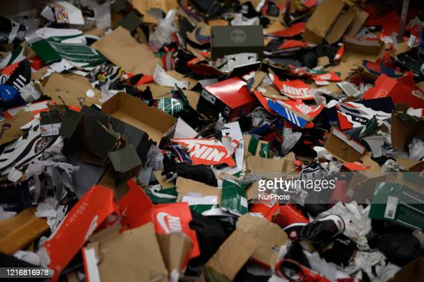 Empty shoe boxes are left on the ground in the storage room of a sneaker store after looters vandalized several business overnight in the Mt...