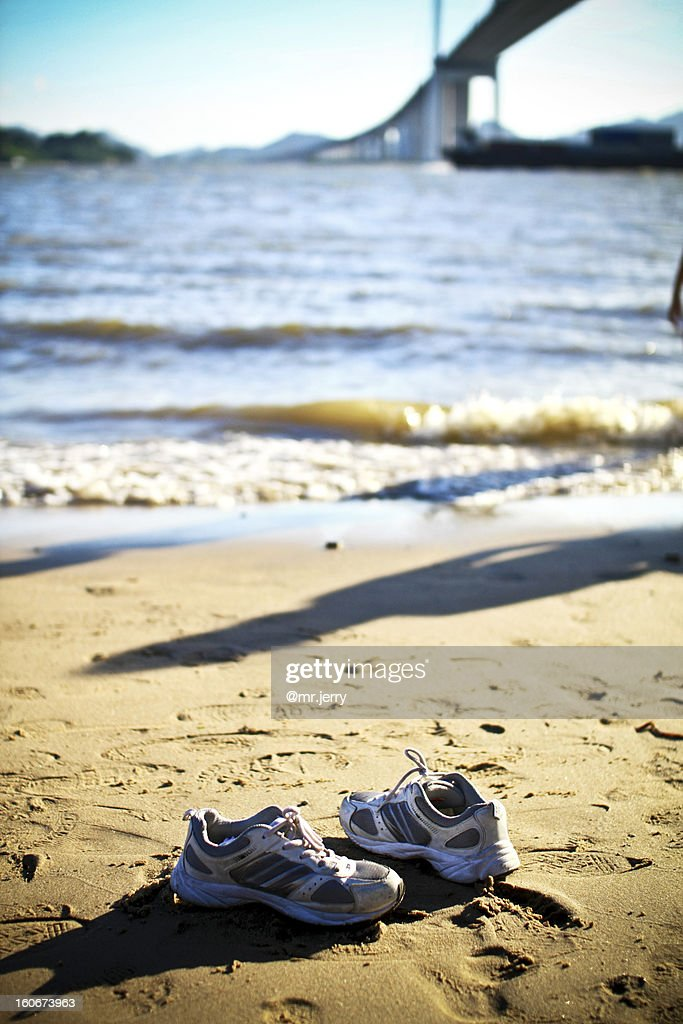 a0930e276 Empty shoes at the beach   Stock Photo