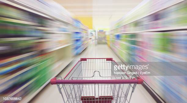 empty shopping cart in supermarket - shopping cart stock pictures, royalty-free photos & images