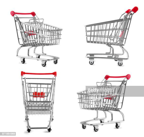 empty shopping carts over white background - shopping cart stock pictures, royalty-free photos & images
