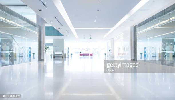 empty shopping centre in sunset, dubai - flooring stock photos and pictures