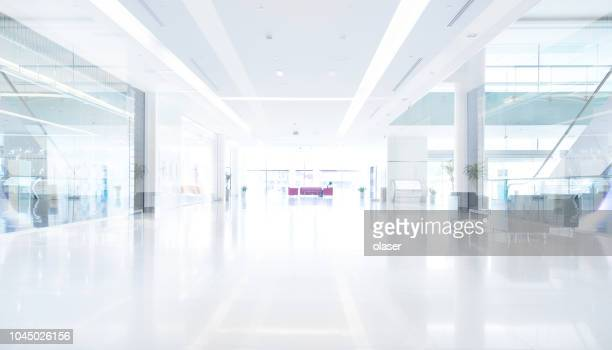 empty shopping centre in sunset, dubai - office background stock pictures, royalty-free photos & images